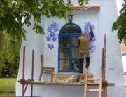 Czech grandmother painting houses